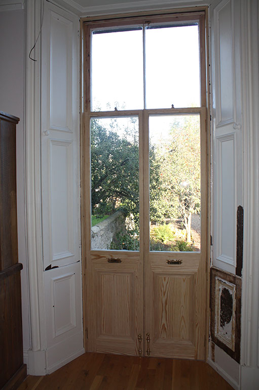 A traditional 'Stirling Door' repaired and restored to full working use with a Traditional Buildings Repair Grant.